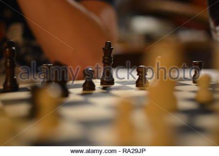 Wooden Chess pieces on a traditional game board. Chess is a strategy game. - Stock Image