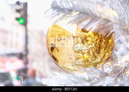 Golden Christmas ball in Paris, France - Stock Image