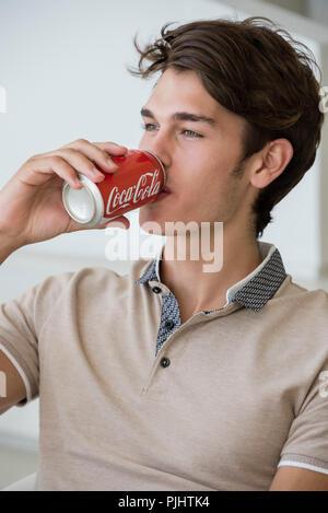 Teenager  drink a coke - Stock Image