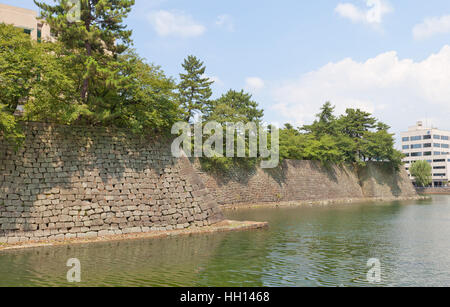 Moat and stone walls of Fukui castle in Fukui, Japan. Castle was founded in 1601 by Yuki Hideyasu and dismantled - Stock Image