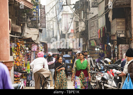 ourists and pilgrims through the polluted streets of Amritsar. Amritsar is a city in northwestern India - Stock Image