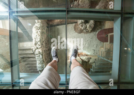Cartagena, Spain - September 14th, 2018: Visitor over the glass floor of Punic Wall Interpretation Center - Stock Image