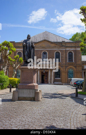 Wesley's Chapel with a statue of John Wesley in the foreground, London England. - Stock Image