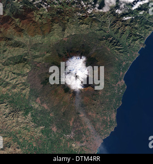 Rivers of black lava snake over the white, snow-covered slopes of Mount Etna in this natural-color satellite image. Dec.13, 2013 - Stock Image