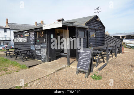 Fisherman's huts on the beach at Aldeburgh in Suffolk selling a range of freshly caught fish - Stock Image