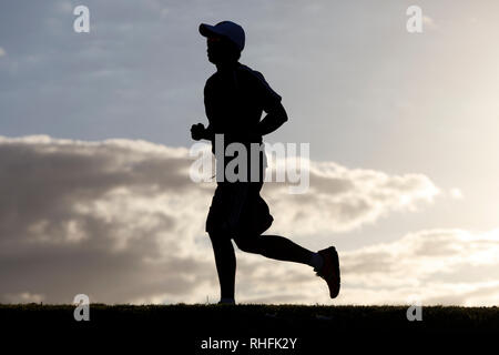 Man jogging in silhouette against the sky, San Juan, Puerto Rico - Stock Image