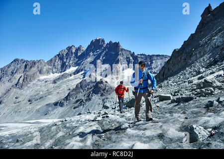 Hiker friends in Mont Cervin, Matterhorn, Valais, Switzerland - Stock Image