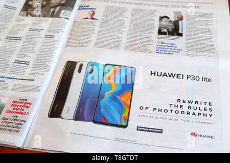 Huawei P30 lite mobile phone advert in a British newspaper 2019  London England UK - Stock Image