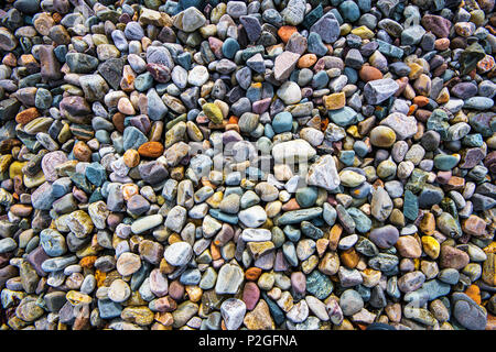 A poster showing the beautiful coloured stones on the shores of the Isle of Skye in the Highlands of Scotland - Stock Image