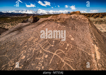 Rock art and Sierra Nevda Range, California. Location secret to protect site Ancient Native American.petroglyphs - Stock Image