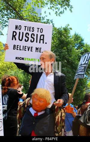 NEW YORK, NY - JULY 02: Activists rally at a Rise and Resist organized Trump Impeachment protest in front of the Trump International Hotel & Tower. - Stock Image