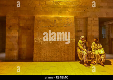 Two Arab men talking at he entrance to the Crocodile Museum at the Temple of Kom Ombo, Aswan, Egypt, Africa - Stock Image