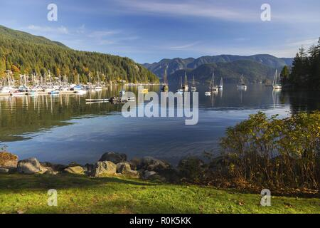 Scenic Landscape View of Indian Arm and Moored Yachts in Deep Cove Marina Urban Park, Vancouver British Columbia, Canada - Stock Image