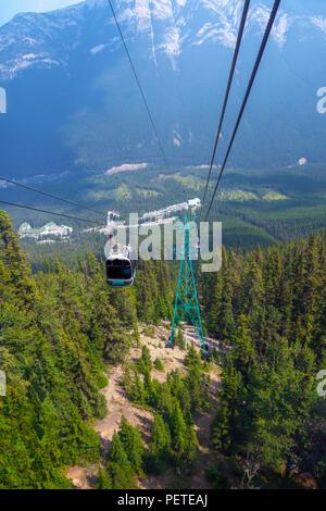 Riding a gondola cable car up Sulphur Mountain in Banff National Park, Alberta, Canada. - Stock Image