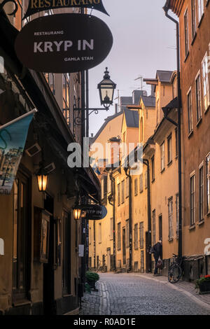 Narrow cobblestone street scene in the historic old town of Gamla Stan, Stockholm, Sweden - Stock Image