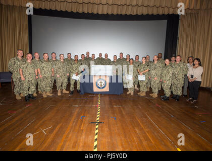 180829-N-QB805-0001 PEARL HARBOR (August 29, 2018) Navy-Marine Corps Relief Society (NMCRS) area coordinators and unit representatives pose for a photo during the NMCRS award ceremony at the Joint Base Pearl Harbor-Hickam theater, August 29, 2018. The NMCRS provides financial relief to active duty and retired Marines and Sailors as well as their eligible surviving family members through interest-free loans and grants. (U.S. Navy photo by Mass Communication Specialist 1st Class Randi Brown) - Stock Image