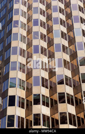 Rectangular windows of a high rise office building forming a repetitive pattern - Stock Image