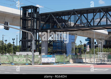 A new elevator and pedestrian overpass that will cross eight lanes of traffic, being built near     station as part of the new Metro train network - Stock Image