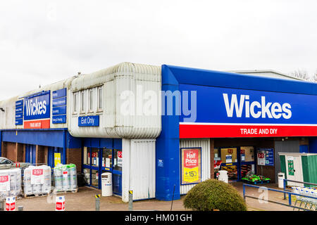 Wickes DIY trade store shop building exterior emblem sign signs UK England stores shops do it yourself building - Stock Image