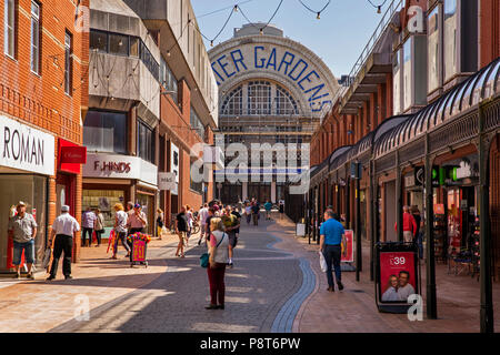 UK, England, Lancashire, Blackpool, Victoria Street, towards Winter Gardens scaffolded during renovation - Stock Image