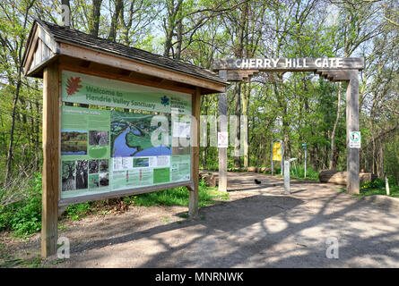 Cherry Hill Gate entrance to hiking trails in Hendrie Valley Sanctuary in Royal Botanical Gardens, Burlington, Ontario, Canada. Squirrel and chipmunk  - Stock Image