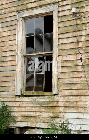 Broken window in the lower 9th Ward New Orleans Louisiana - Stock Image