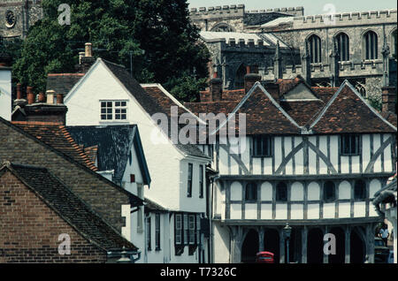 Thaxted Guildhall and Church in 1978, Thatxted Essex England UK The Guildhall at the time was painted incorrectly. The 'Tudor effect' was incorrect instead the timber work should have been Lime Washed. - Stock Image