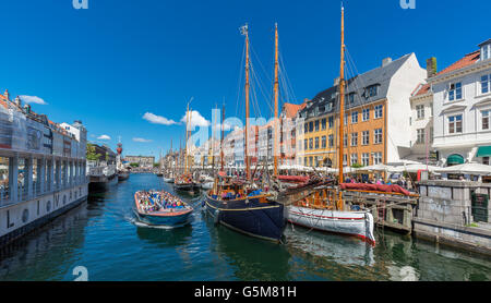 Excursion boat, Nyhavn canal, Copenhagen, Denmark - Stock Image