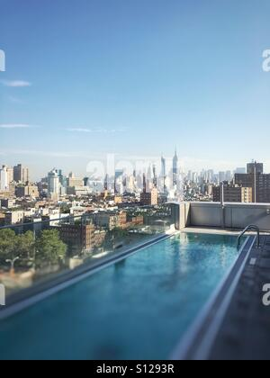 Roof top pool in Manhattan from East Village (Hotel Indigo), New York, NY - Stock Image