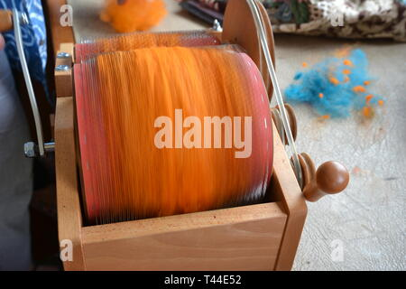 Spun sheeps wool at the Sheep to Shawl Challenge taking place at Orford Ness, Suffolk, UK - Stock Image