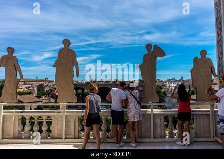 Rome, Italy - 24 June 2018: Tourists taking a picture of the ancient ruins at the Roman Forum, Palatine hill in Rome - Stock Image