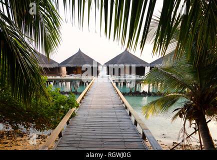 Holiday Villas on Kuramathi Island, Rasdhoo Atoll, the Maldives Asia - Stock Image