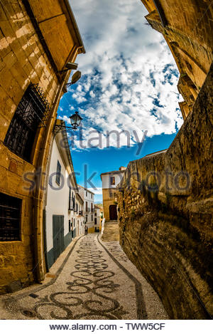 Intricate stone patterns called 'empedrados', Calle Baja Iglesia,, Alhama de Granada, Granada Province, Andalusia, Spain. - Stock Image
