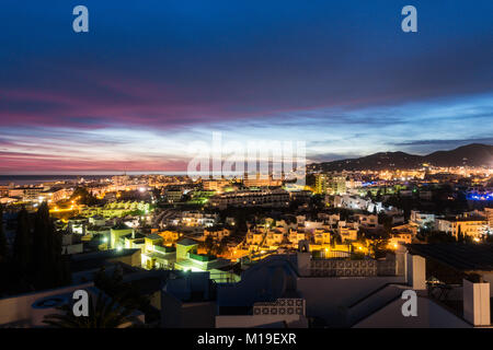 Evening view over the rooftops of Nerja, Spain and out to see with faint cruisliner on the horizon line - Stock Image