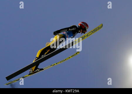 Bischofshofen, Austria. 05th, Jan 2018. Eisenbichler Markus from Germany soars through the air during the qualification - Stock Image