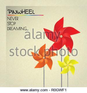 Colorful orange, red and yellow pinwheels - Stock Image