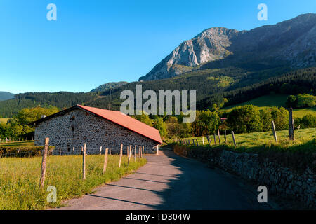 rural landscape in Axpe with view of Anboto mountain - Stock Image