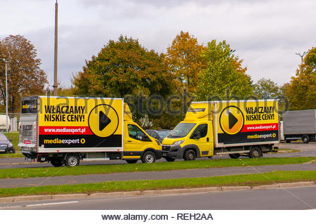 Poznan, Poland - October 7, 2018: Two parked Mediaexpert electronics store delivery trucks by a road. - Stock Image