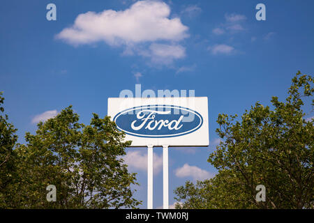 large advertising sign at the Ford automobile factory in the town district Niehl, Cologne, Germany.  grosses Werbeschild an den Ford-Werken in Niehl, - Stock Image
