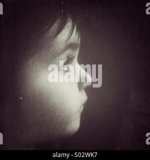 Toddler Caucasian girl portrait in black and white. - Stock Image