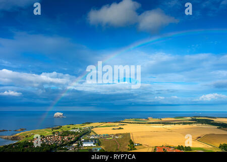 The Bass Rock and rainbow from the summit of North Berwick Law, East Lothian, Scotland, UK - Stock Image