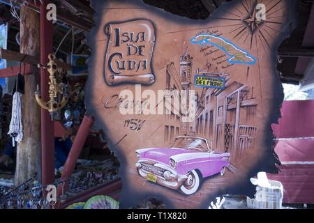 Detail in a Tourist Souvenir Shop showing Amateur Drawing of Classic Cuban Old Car and Colonial Architecture on Cayo Largo Del Sur Island in Cuba - Stock Image