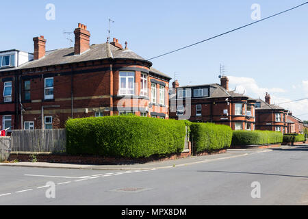 Large end terrace houses with unusual full-height windowed bays on Arthington Street, Leeds. The houses were built in the late 19th century. - Stock Image