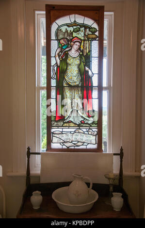 Leadlight window in a nun's cell at the 19th century Convent Gallery in the gold rush-era town of Daylesford, - Stock Image