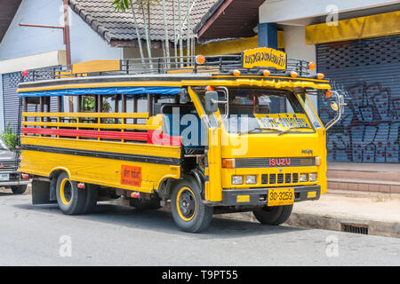 Phuket, Thailand - May 20th 2010: Yellow school bus. This is typical of bus transport on the island. - Stock Image