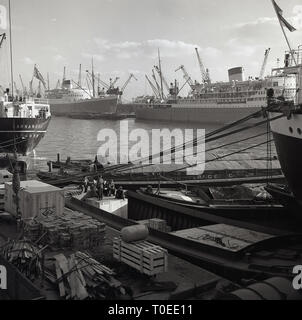 1950s, large ships moored in Belfast harbour,  Northern Ireland - Stock Image