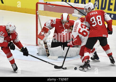 Bratislava, Slovakia. 19th May, 2019. L-R Simon Moser and goaltender Leonardo Genoni (both SUI), Yevgeni Dadonov (RUS) and Lukas Frick (SUI) in action during the match between Austria and Czech Republic within the 2019 IIHF World Championship in Bratislava, Slovakia, on May 19, 2019. Credit: Vit Simanek/CTK Photo/Alamy Live News - Stock Image