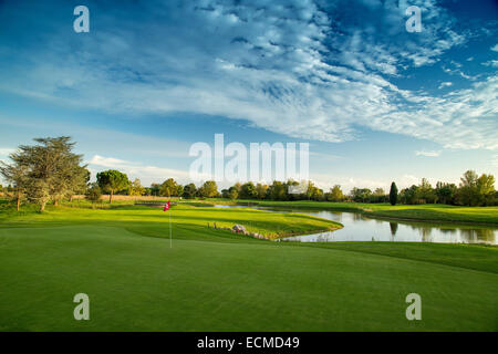 Golf course in the sun - Stock Image