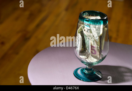 tips jar on counter top - Stock Image