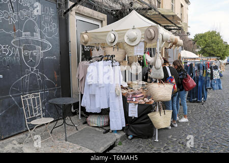 LX Factory street market selling white fashion clothing, straw hats, linen clothing and shoulder bags Alcantara Lisbon Lisboa Portugal  KATHY DEWITT - Stock Image